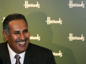 Qatar's Prime Minister Sheikh Hamad Bin Jassim Bin Jabr Al-Thani smiles during a news conference at Harrods in London